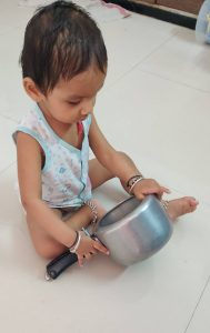 Baby Playing in Kitchen